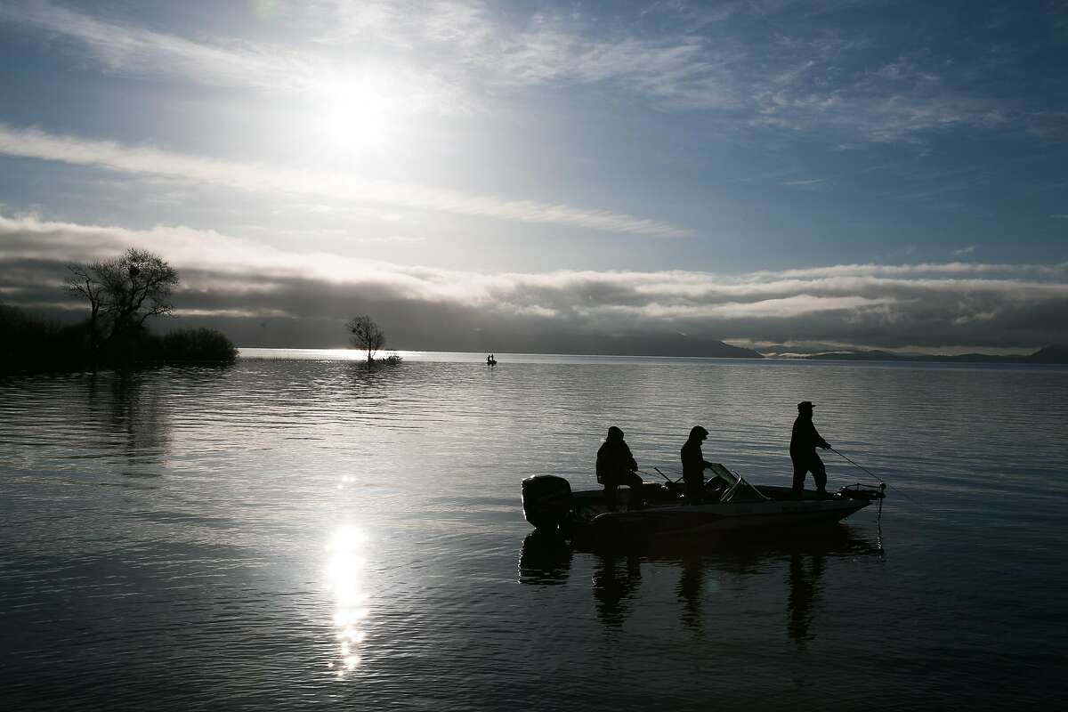 Fishermen fish near the shorelines on Clear Lake in Lakeport, Calif. Saturday, March 25, 2017.