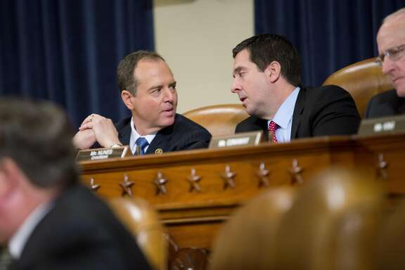 Rep. Adam Schiff (D-Calif.), ranking member, left, with Rep. Devin Nunes (R-Calif.), committee chairman, during testimony from FBI Director James Comey and National Security Agency Director Adm. Michael Rogers at a hearing before the House Permanent Select Committee on Intelligence on Capitol Hill, in Washington, March 20, 2017. Comey publicly confirmed an investigation into Russian interference in the presidential election and whether associates of the president were in contact with Moscow at the hearing Monday. (Eric Thayer/The New York Times)