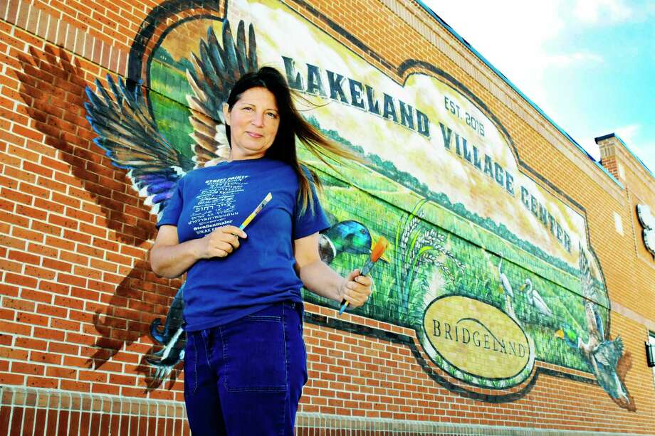 Bridgland  Mural Artist, Lakeland Village Center. 10515 Fry rd ,Cypress, Texas, 03/30/2017  (Caption ) Mural urban artist  Anat Ronen , paints a beautiful mural on the wall   of one of the commercial building  at the Bridgeland lakeland village center. Anat created ideal of the mural choosen for the wall. Photo: Tony Gaines, Photographer