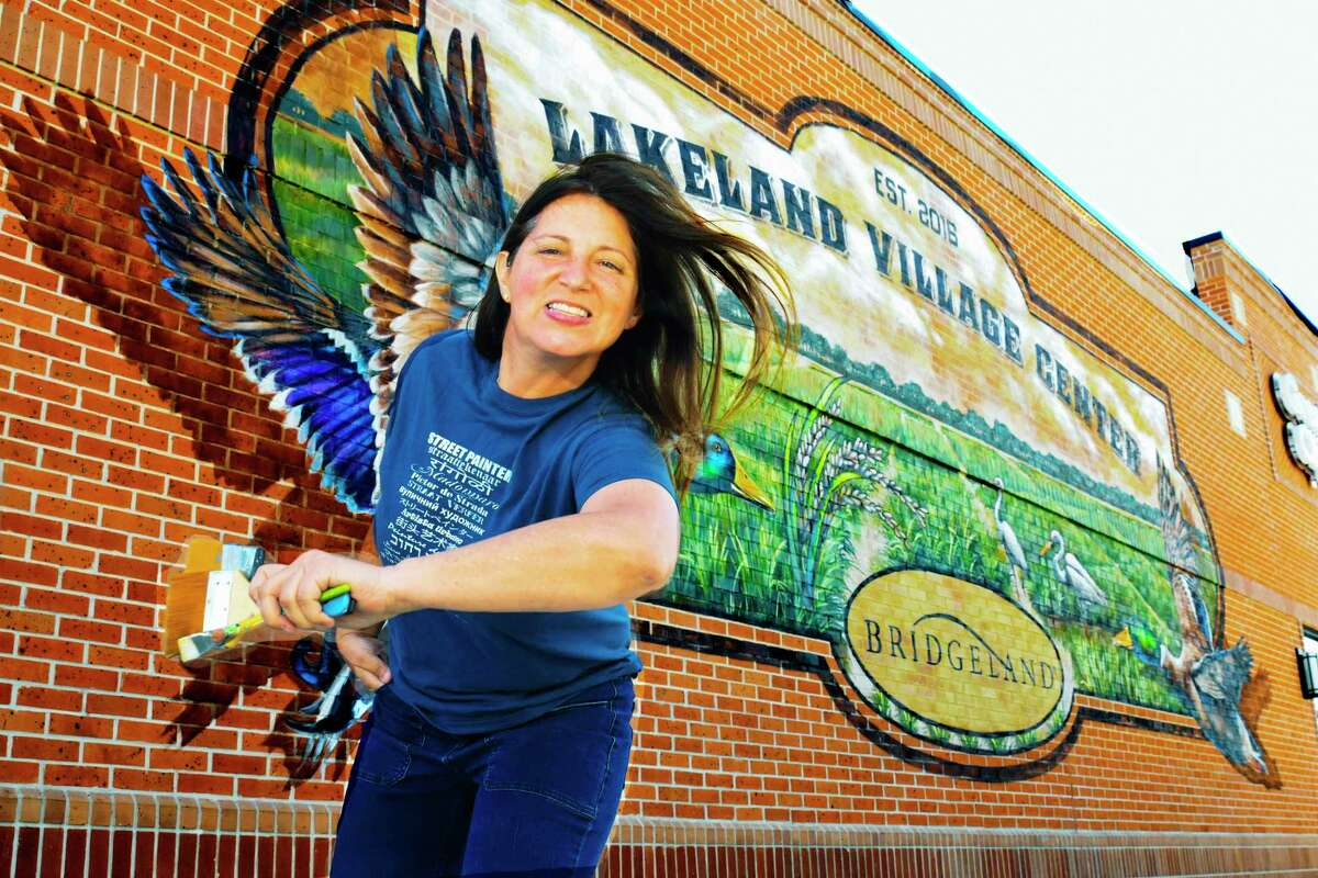 Bridgland Mural Artist, Lakeland Village Center. 10515 Fry rd ,Cypress, Texas, 03/30/2017 (Caption ) Mural urban artist Anat Ronen , paints a beautiful mural on the wall of one of the commercial building at the Bridgeland lakeland village center. Anat created ideal of the mural choosen for the wall.