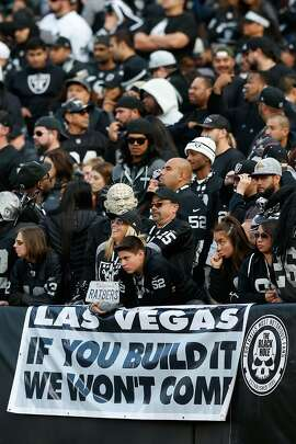 OAKLAND, CA - NOVEMBER 27:  Oakland Raiders fans stand behind a sign referencing a potential move by the team to Las Vegas during their NFL game against the Carolina Panthers on November 27, 2016 in Oakland, California.  (Photo by Lachlan Cunningham/Getty Images)