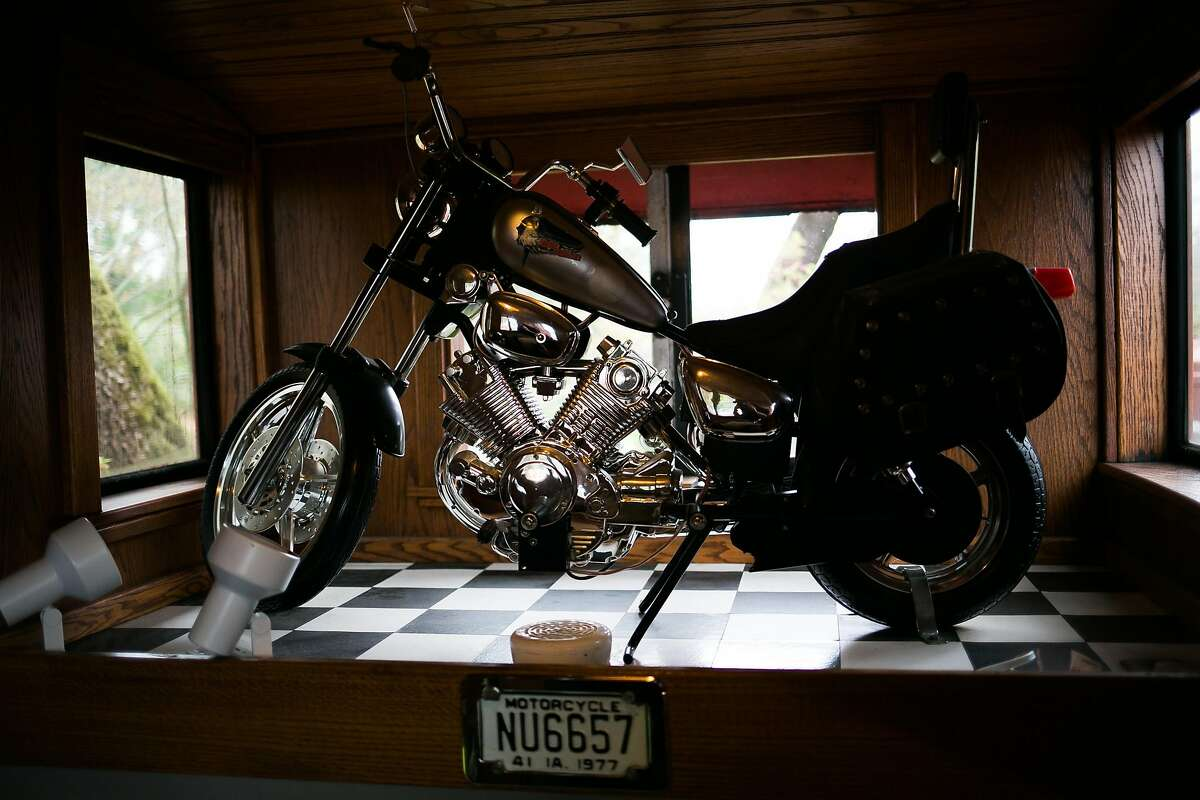 The motorcycle-themed room includes a miniature replica Harley-Davidson.