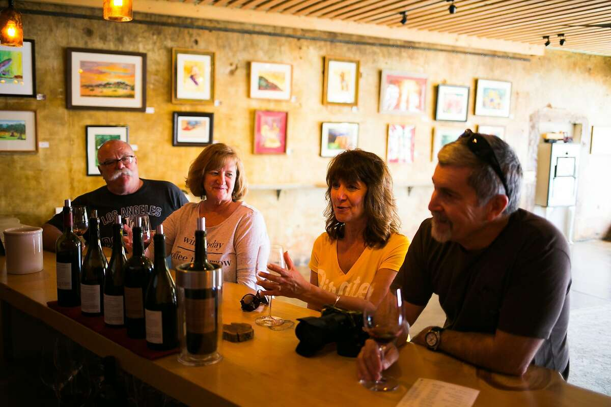 From the far left, Chris Kelley and Donna Kuckhoff of Reno with Ellie Brown and Dean Brown of Susanville enjoy their wines at the Fore Family Vineyards Wine Room in Kelseyville.