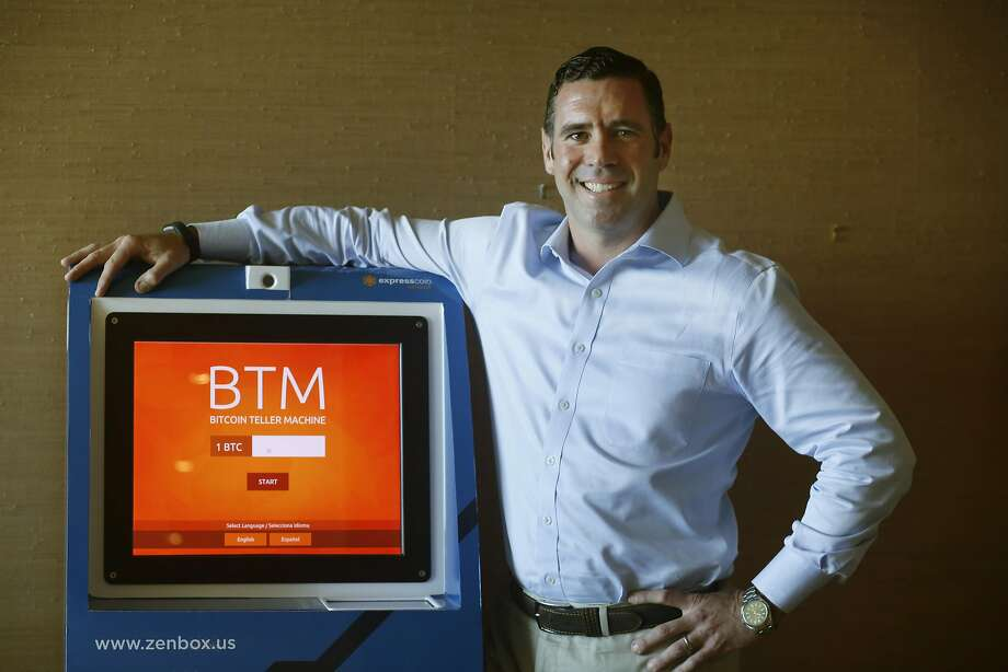 Bart Stephens, managing partner of Blockchain Capital,  stands next to a bitcoin ATM. Photo: Lea Suzuki, The Chronicle