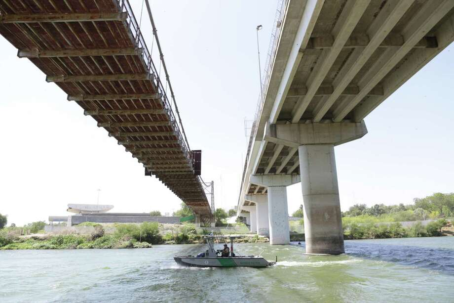 A Border Patrol boat travels east on the Rio Grande River under the old historic bridge I n Roma, TX on Thursday, March 23, 2017. Assaults to Customs Border Protection Agents, especially to the boat patrol crews have increased. Photo: Bob Owen, Staff / San Antonio Express-News / San Antonio Express-News