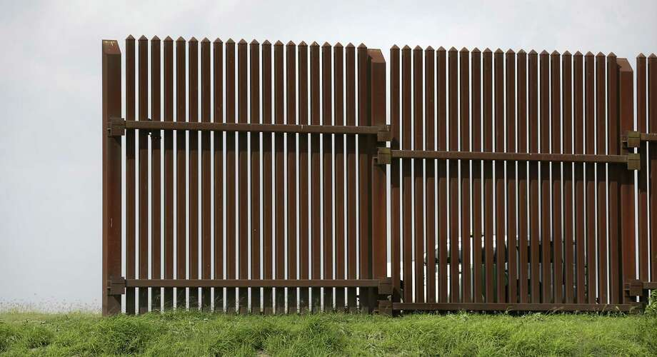 A Customs and Border Protection Agent vehicle patrols the border wall in Los Indios earlier this year. Photo: Bob Owen /San Antonio Express-News / ©2017 San Antonio Express-News
