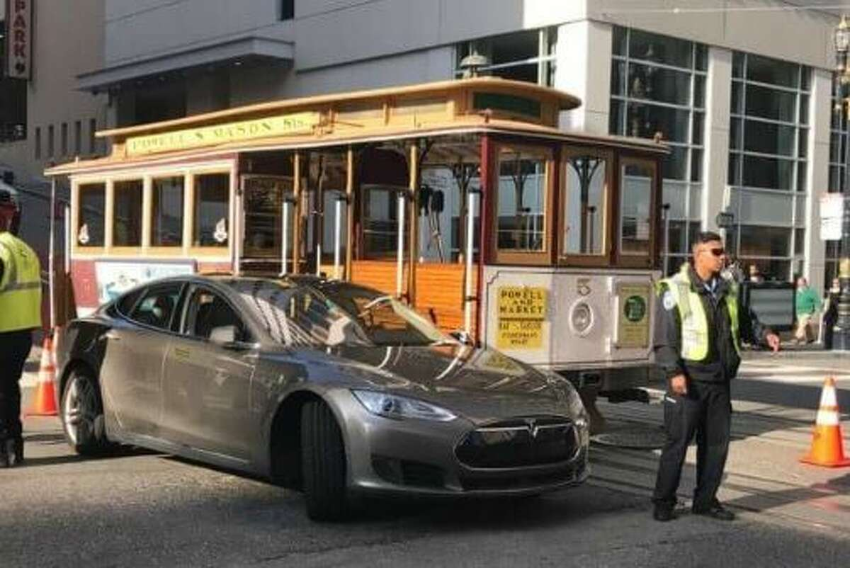 It wasn't immediately clear who was at fault, the gripman of the iconic cable car or the driver of state-of-the-art electric Tesla.