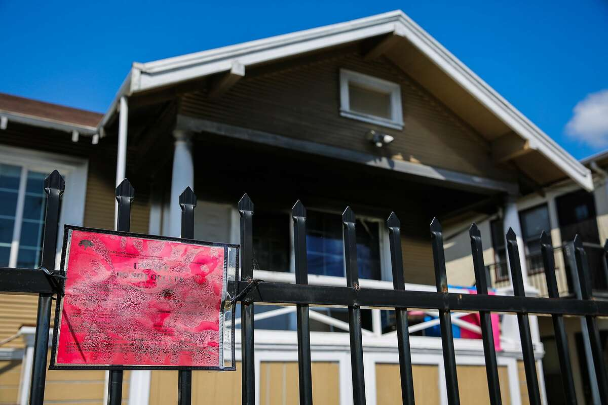A red placard is seen posted in front of a home on the 2900 block of 35th Street in Oakland, California, on Thursday, March 30, 2017. The home has been redtagged because of fire, smoke and water damage.