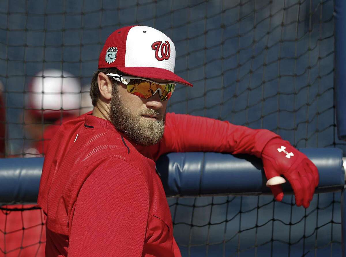 Washington Nationals right fielder Bryce Harper watches batting practice before a spring training game against the New York Yankees on March 20, 2017, in West Palm Beach, Fla.