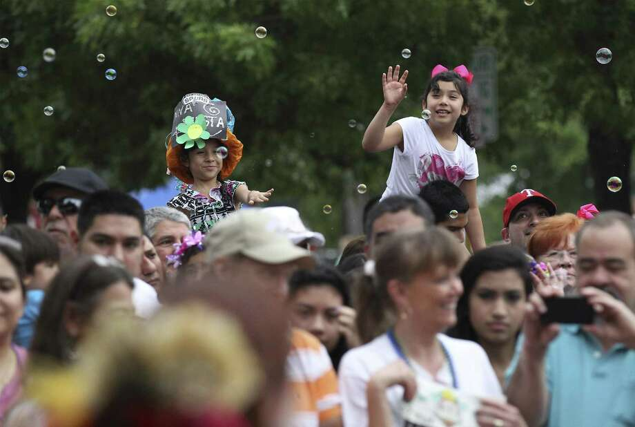 The King William Fair — which begins with a parade (shown in 2014) — is a popular Fiesta event for families. Keep scrolling for a few quick tips on how to navigate San Antonio's 10-day citywide party. Photo: Kin Man Hui /San Antonio Express-News / ©2014 San Antonio Express-News