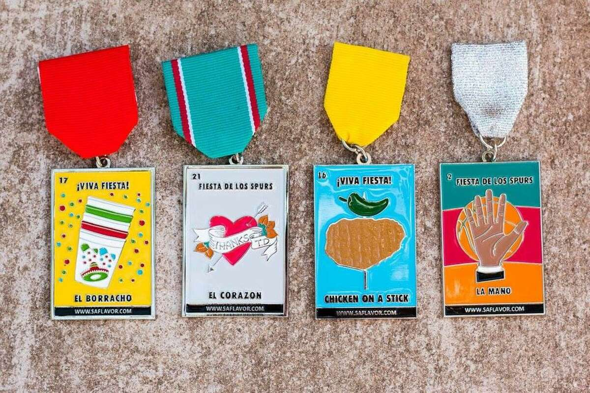 """San Antonio blog SA Flavor offers several lotería-themed Fiesta medals for $10 each at store.saflavor.com. From left are this year's El Borracho and El Corazon medals, followed by the 2016 medals Chicken on a Stick and La Mano. $1 from each sale of SA Flavor's """"El Corazon"""" and """"El Borracho"""" medals goes to Child Advocates of San Antonio and Snack Pak 4 Kids, respectively."""