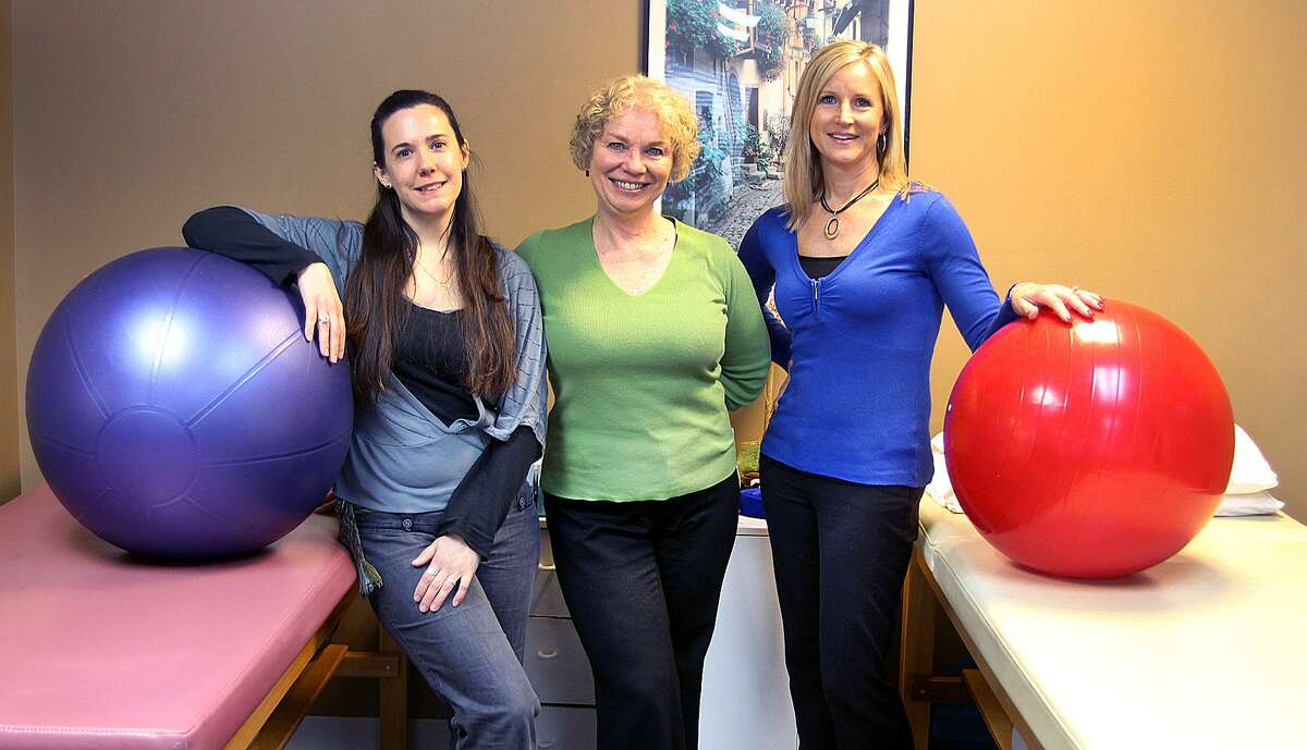 Caitlin deDufour, Karen Schwarzchild and Christine Bray of Physical Therapy Arts stand in the physical therapy room of their New Fairfieid, Conn., location on Friday, March 31, 2017.