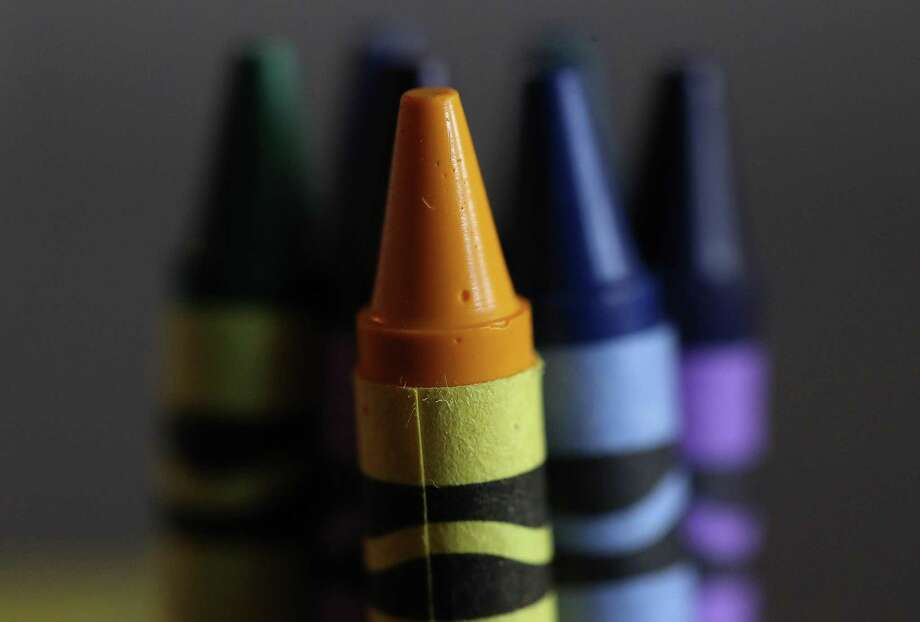 Crayola announced that they will be eliminating the dandelion yellow crayon (front) from its color lineup and will replace it with a blue color in May. Photo: Justin Sullivan /Getty Images / 2017 Getty Images