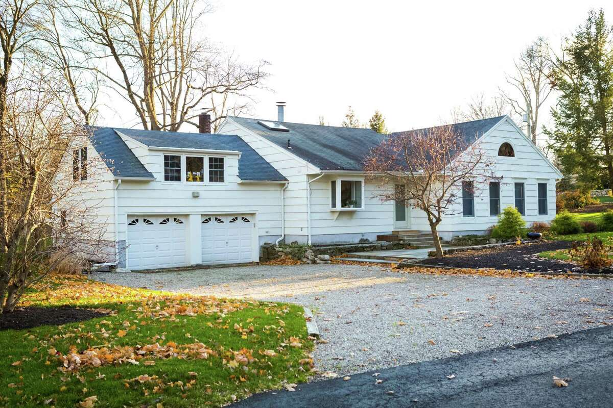 The contemporary house at 10 Burr Farms Road is on a cul-de-sac in the Long Lots neighborhood, an easy commute to Post Road, Interstate 95, shops and restaurants. It is also within walking distance to local schools.