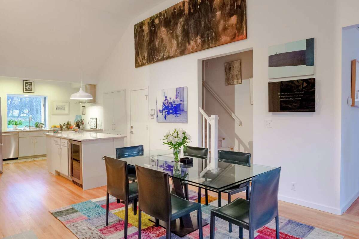 The newly renovated kitchen is open to the dining room.