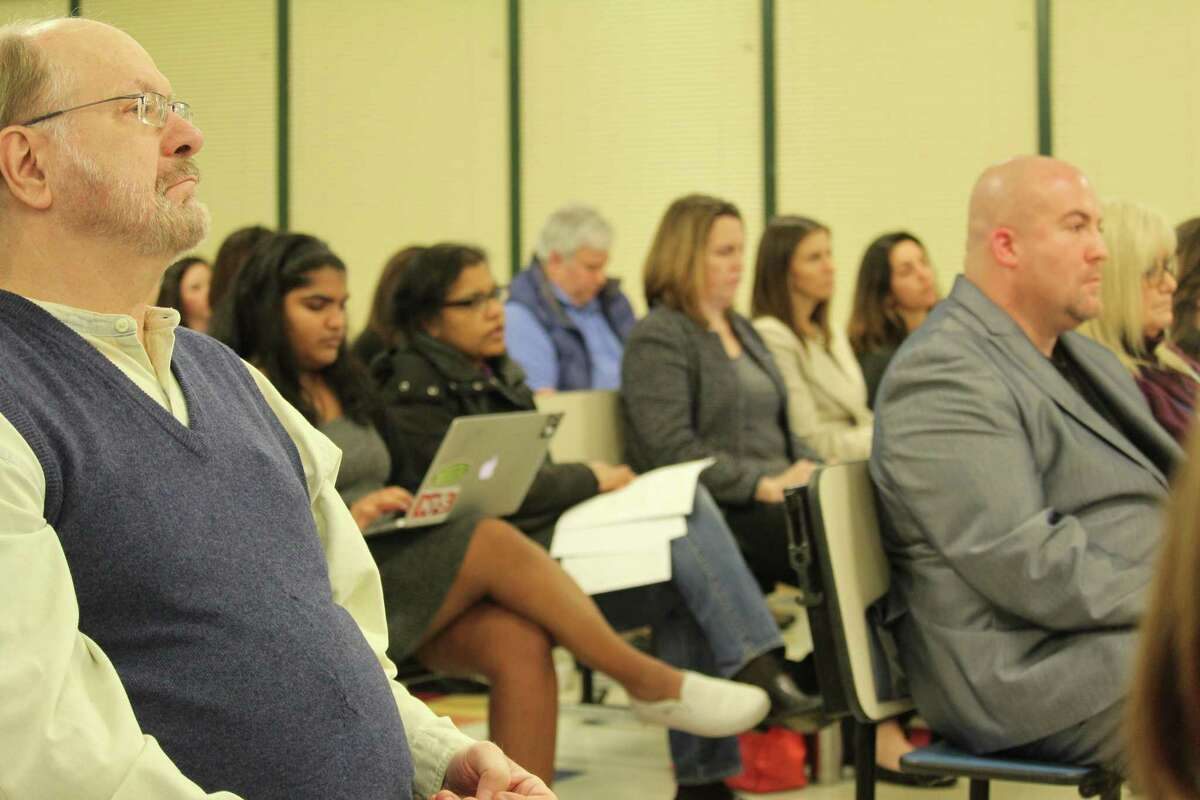 Members of the school community, concerned about the school budget reductions, watch the discussion at the March 27, 2017 Board of Education meeting.