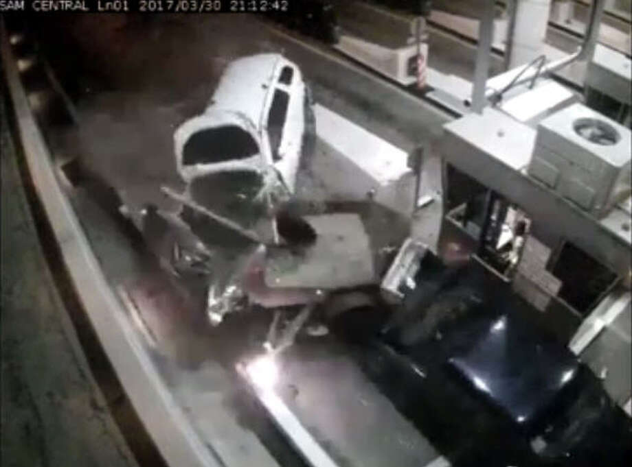 A man is dead after his car was hit at a toll booth Thursday night in northwest Houston on Beltway 8. The man was paying the toll around 9:30 p.m. near the West Little York exit when another driver lost control of his Dodge Durango and slammed into the back of the man's car. Photo: HCTRA