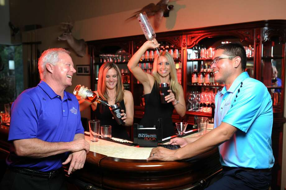 John Morrow, president of Rebecca Creek Distillery (far left), and Mark Marquez, territory manager of Rebecca Creek Distillery (far right), enjoy drinks made with Texas Ranger whiskey and Enchanted Rock vodka mixed by Heather Godfrey (center left) and Jamie Rogers (center right) of Just Right Cocktails on March 24, 2017. James Durbin/Reporter-Telegram Photo: James Durbin