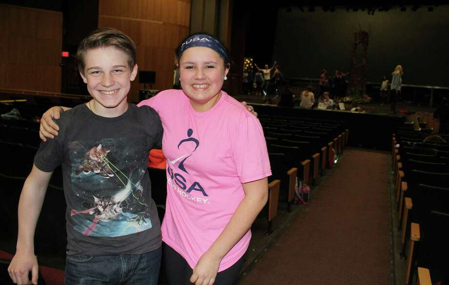 "Jackson LaMorte, who plays the king, and Megan Lydon, who portrays the fairy godmother, hang out before a rehearsal of Saxe Middle School's production of ""Cinderella."" The show will debut March 31 at New Canaan High School . Photo: Erin Kayata / Hearst Connecticut Media / New Canaan News"