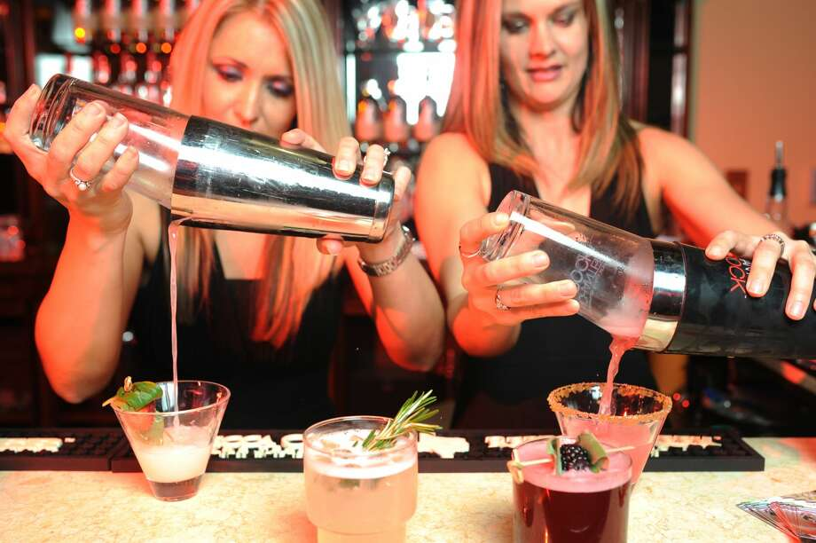 Jamie Rogers (left) and Heather Godfrey (right) of Just Right Cocktails mix drinks made with Texas Ranger whiskey and Enchanted Rock vodka March 24, 2017. James Durbin/Reporter-Telegram Photo: James Durbin