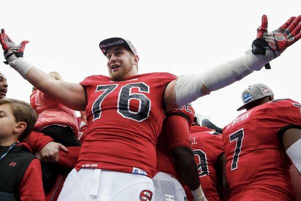 BOWLING GREEN, KY - DECEMBER 03: Forrest Lamp #76 of the Western Kentucky Hilltoppers celebrates following the game against the Louisiana Tech Bulldogs at Houchens-Smith Stadium on December 3, 2016 in Bowling Green, Kentucky. Western Kentucky defeated Louisiana Tech 58-44. (Photo by Michael Hickey/Getty Images)