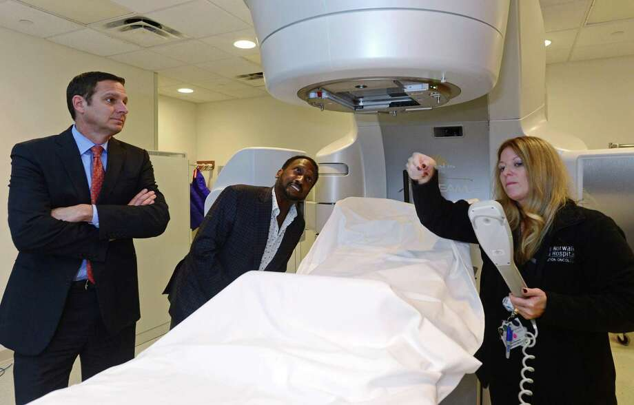 Norwalk Hospital President Mike Daglio, left, tours in October 2016 the Norwalk, Conn. institution's new C. Anthony and Jean Whittingham Cancer Center. Under Daglio and Western Connecticut Health Network CEO Dr. John Murphy, Norwalk Hospital generated revenue in excess of expenses of $42 million in fiscal 2016. Photo: Erik Trautmann / Hearst Connecticut Media / Norwalk Hour