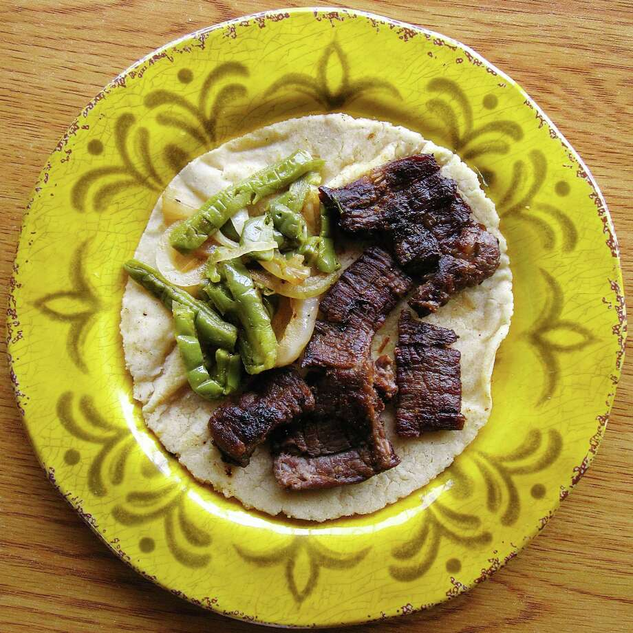 Carne asada taco with onions and nopales on a handmade corn tortilla from La Patrona Family Mexican Restaurant on U.S. 181 South. Photo: Mike Sutter /San Antonio Express-News