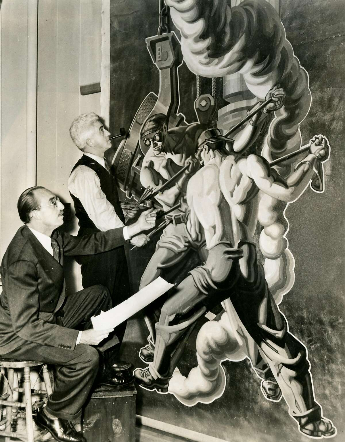"""From the back of the photo: """"Featured in the General Motors exhibit at the San Francisco Fair, on Treasure Island in 1939, are the murals """"Strength and Safety,"""" designed by Dean Cornwell, N.A., and executed by George Davidson, A.N.A., and Carlo Ciampagliia, A.N.A. Done in full color on canvas, they were in the exhibit of the Fisher Body Division. The murals were characterized by experts as among the finest artistic endeavors to be seen at the fair, ranking with other important works of Cornwell, one of America's foremost artists. In the above photo, Cornwell (seated) is shown with Ciampaglia, as the murals neared completion in the artist's studio."""""""