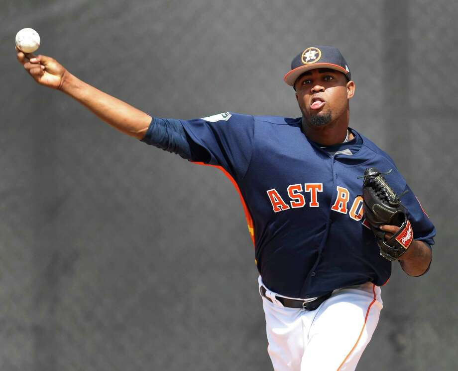 Houston Astros relief pitcher Jandel Gustave (61) pitches as the Astros pitchers and catchers held their first workout of spring training at The Ballpark of the Palm Beaches, in West Palm Beach, Florida, Tuesday, February 14, 2017. ( Karen Warren / Houston Chronicle ) Photo: Karen Warren, Staff Photographer / 2017 Houston Chronicle
