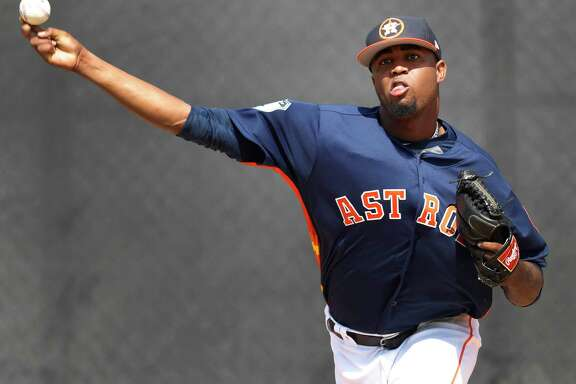 Houston Astros relief pitcher Jandel Gustave (61) pitches as the Astros pitchers and catchers held their first workout of spring training at The Ballpark of the Palm Beaches, in West Palm Beach, Florida, Tuesday, February 14, 2017. ( Karen Warren / Houston Chronicle )