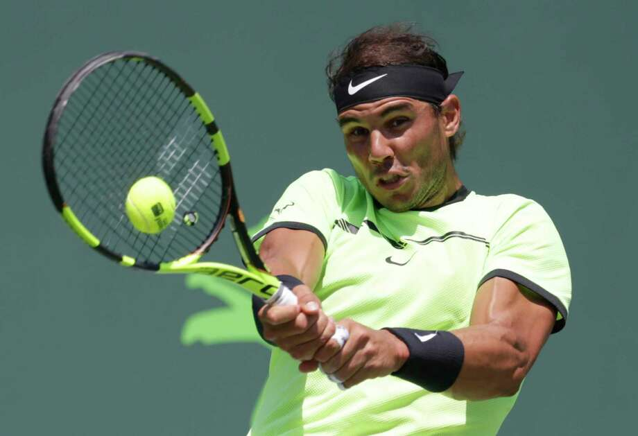 Rafael Nadal, of Spain, hits a return to Fabio Fognini, of Italy, during a men's semifinal match at the Miami Open tennis tournament, Friday, March 31, 2017, in Key Biscayne, Fla. (AP Photo/Lynne Sladky) Photo: Lynne Sladky, STF / Copyright 2017 The Associated Press. All rights reserved.