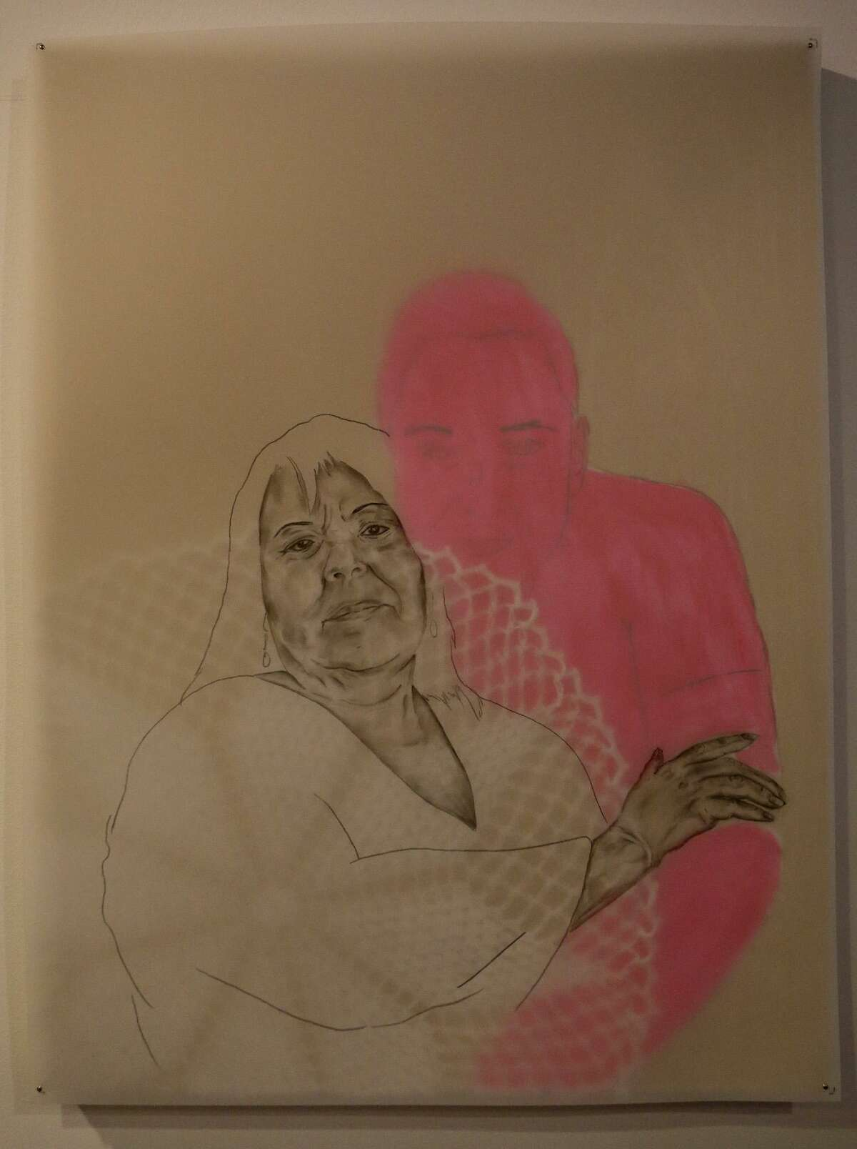 """This mixed-media pieces by Jose Villalobos was one of the works in """"Interconnectedness,"""" a two-part group exhibit exploring the mother-child relationship he organized at Clamp Light. The pink figure in the background is a self-portrait of the artist."""