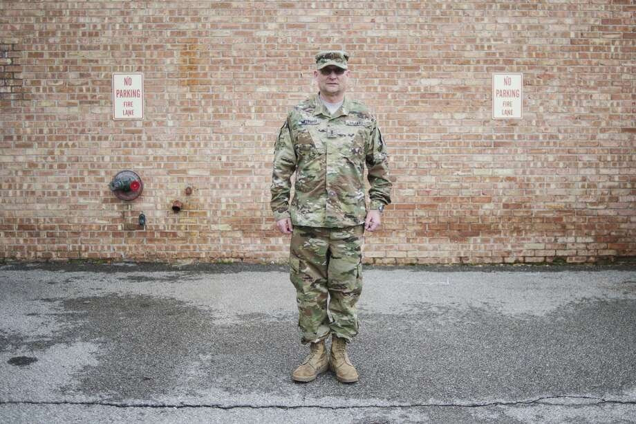 """Chief Warrant Officer Kevin McDevitt poses for a portrait on Friday at the Midland Armory. The Midland Army National Guard is a finalist for the Army Award for Maintenance Excellence (AAME). The AAME is an international competition that highlights cleanliness and readiness in licensing procedures, weapon systems and equipment. """"It's a big deal for a National Guard unit to win,"""" First Lt. Steven Oganyan said. """"It is tremendous."""" McDevitt is the Unit Maintenance Offier. Photo: Erin Kirkland/Midland Daily News"""