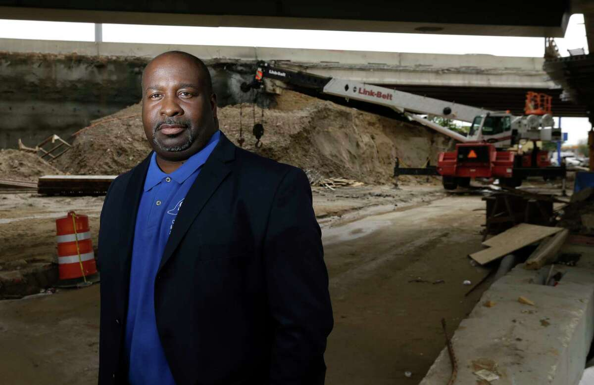 Jerry Sowells, president of Sowells Construction Management & Inspection, poses near a highway construction site on March 29.
