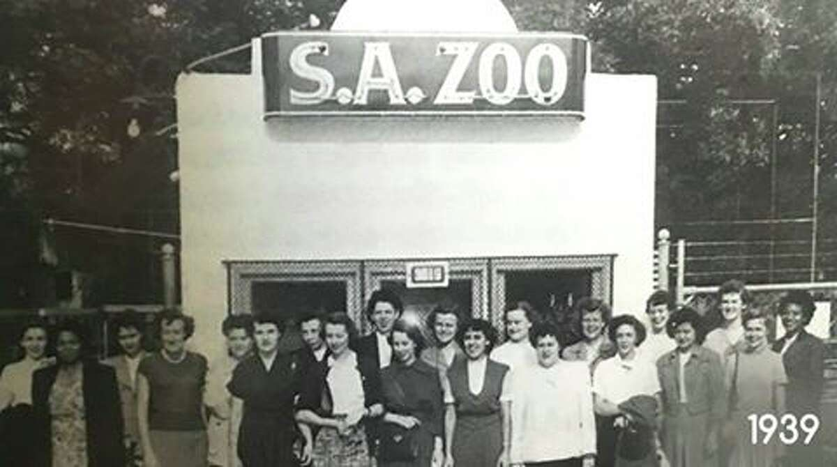 """The black and white photo, dated 1939, shows a group of women standing outside the San Antonio zoo entrance with a simple """"S.A. ZOO"""" signage."""