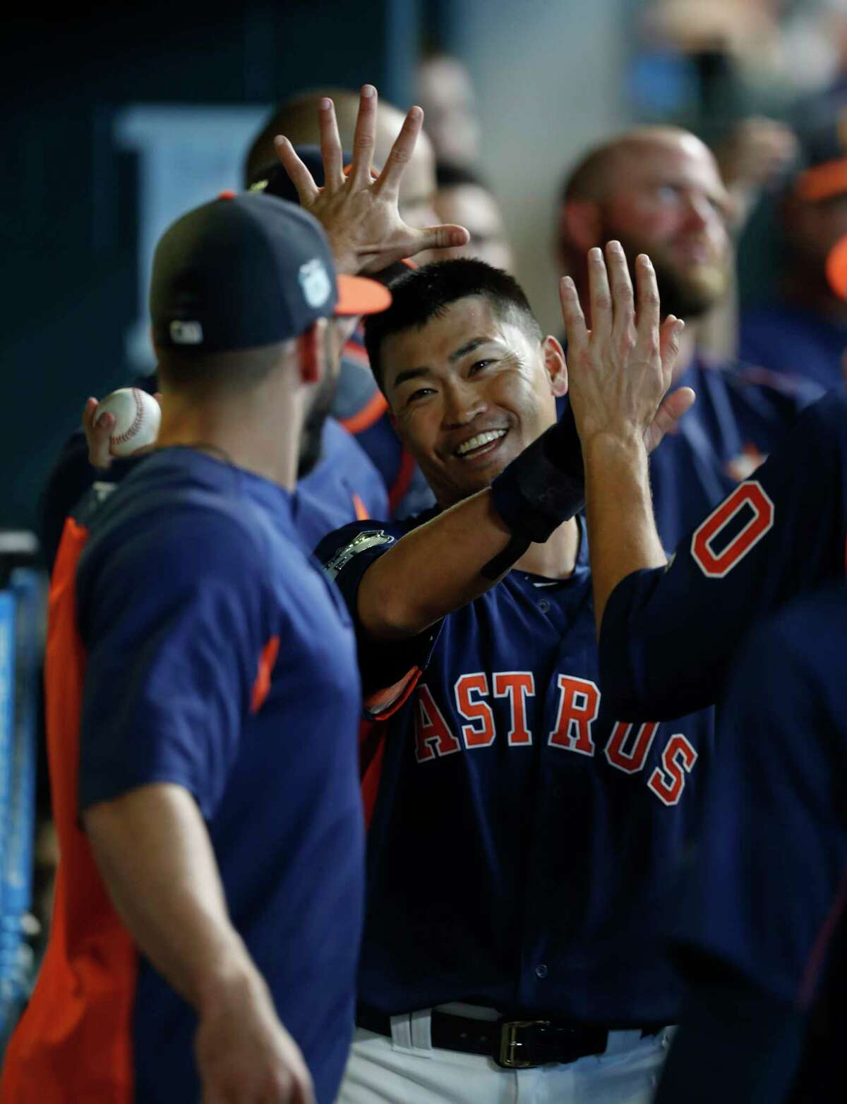 Houston Astros left fielder Norichika Aoki (3) celebrates his run scored in the dugout during the sixth inning of an MLB exhibition game at Minute Maid Park, Friday, March 31, 2017, in Houston.