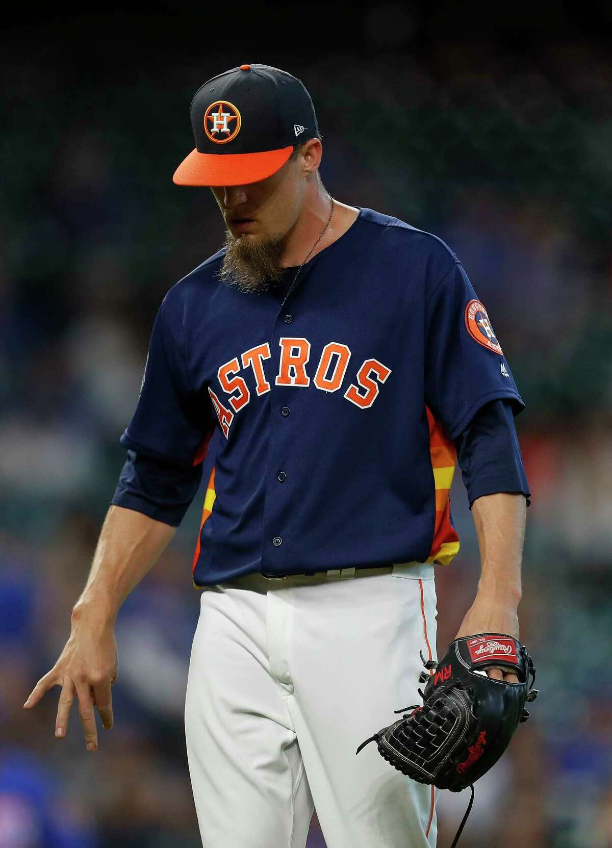 Houston Astros relief pitcher Ken Giles (53) shakes his hand as he walked back to the dugout after getting out of the during the X inning of an MLB exhibition game at Minute Maid Park, Friday, March 31, 2017, in Houston.