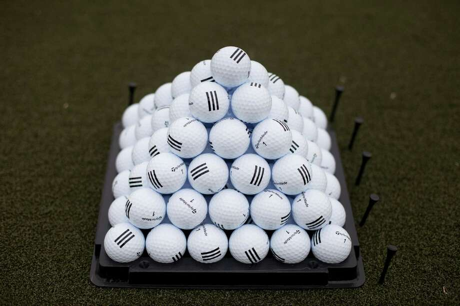 File photo of golf balls sit stacked on the practice field at the Trump Links golf course in the Bronx borough of New York. Photo: Victor J. Blue /Bloomberg / © 2015 Bloomberg Finance LP