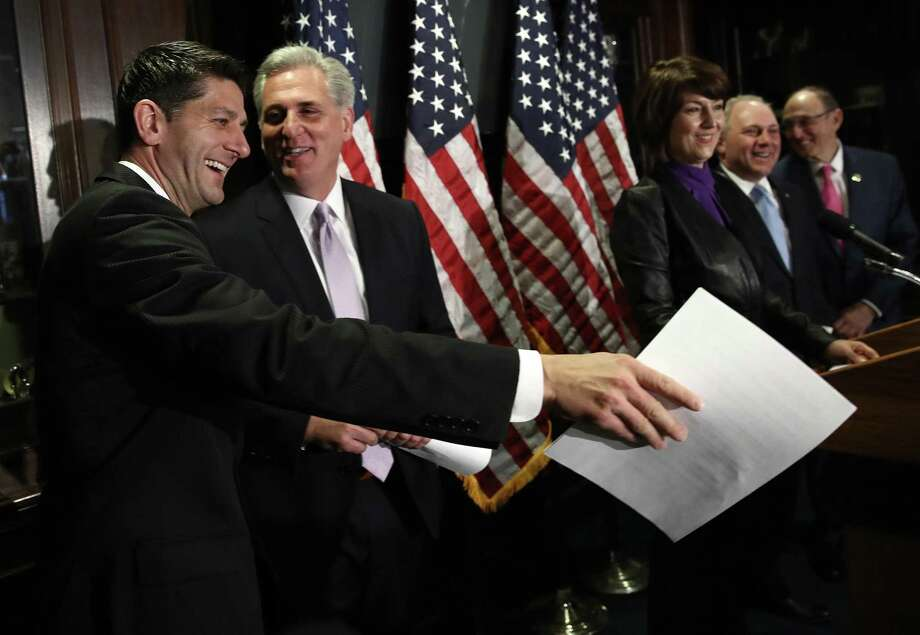 House Speaker Paul Ryan jokes with House Majority Leader Kevin McCarthy during a press conference about two weeks before the failure of their   health care legislation. Readers say a new bill should create coverage that applies to both the average citizen and to every member of Congress. Photo: Win McNamee / Getty Images / 2017 Getty Images