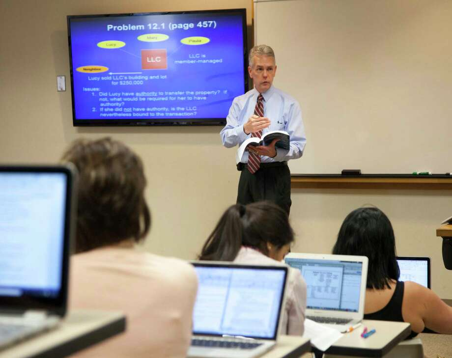 Professor and associate dean Bruce McGovern teaches a South Texas College of Law Houston class. McGovern is a nationally recognized expert in federal taxation. / John Everett