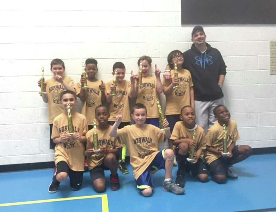 Notre Dame won the Biddy League championship last week. Team members include, from left: front, Kostaki Panagiotidis, Shawn Ahumuza, Matt Rinaldi, Christian Ewers, Ethan Hudson; back, Aiden Soyland, Jermel Bynum, Angel Collazo, Chase DePalmaa, Aiden Erive, coach Jason DePalma. Photo: John Nash / Hearst Connecticut Media / Norwalk Hour