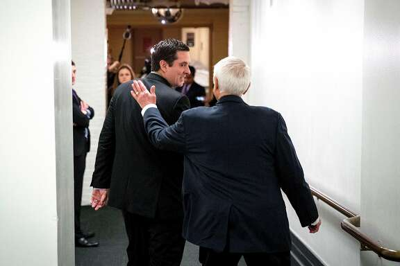 Rep. Devin Nunes (R-Calif.), chairman of the House Intelligence Committee, gets a  pat on the back from Rep. John Carter (R-Texas) following a House Republican conference meeting on Capitol Hill in Washington, March 28, 2017. Top House Democrats called on Nunes to recuse himself from the panel�s investigation into Russian meddling in the 2016 presidential election, thrusting the entire inquiry into jeopardy amid what they described as mounting evidence he was too close to President Trump to be impartial. (Doug Mills/The New York Times)