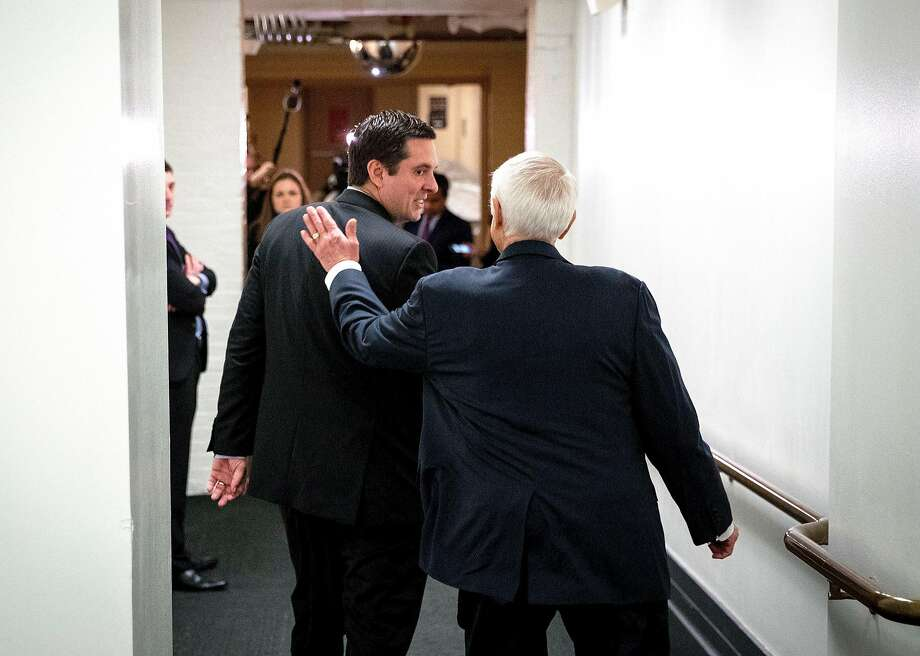 Rep. Devin Nunes, the GOP chair of the House Intelligence Committee who is under fire for his handling of the probe of Russian election meddling, gets a pat from Rep. John Carter, R-Texas. Photo: DOUG MILLS, NYT