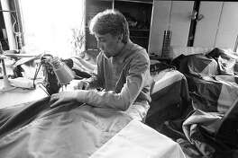 Gilbert Baker, artist who designed the Rainbow Flag, making 500 new flags for an installation on Market St.  06/10/1998 Gay Rights Project