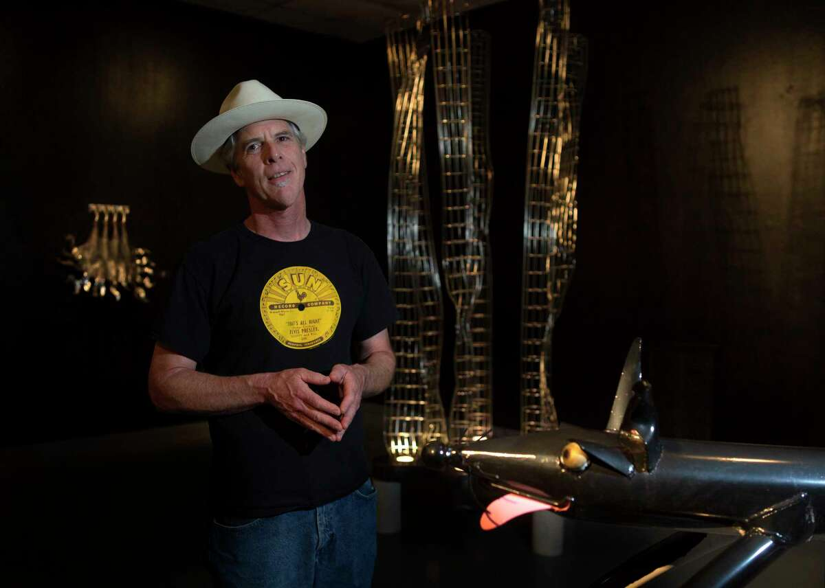 """Sculptor Tim Glover amidst his show """"Working in the Margins"""" currently on display at the Art Car Museum, Wednesday, March 29, 2017, in Houston. (Mark Mulligan / Houston Chronicle)"""