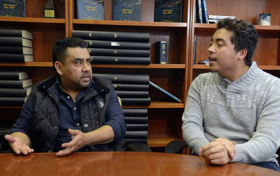 At left, Carmelino Lopez speaks about his latest check-in a week ago in Hartford with U.S. Immigration officials, where two agents escorted him across the street to a company that fitted him with an ankle monitor. Lopez was accompanied by his nephew, Michael Lopez, 19, of Stamford, at right, a U.S. Citizen by Birth, interpreted for his uncle, who came to the U.S. from Guatemala in 1997 and has lived for most of that time in Stamford. Photo: Matthew Brown / Hearst Connecticut Media / Stamford Advocate