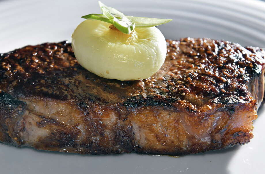 Keep clicking to learn more about a few local restaurants we've reviewed where you can get a good steak and a whole lot more. Photo: John Carl D'Annibale, Albany Times Union / 20040023A