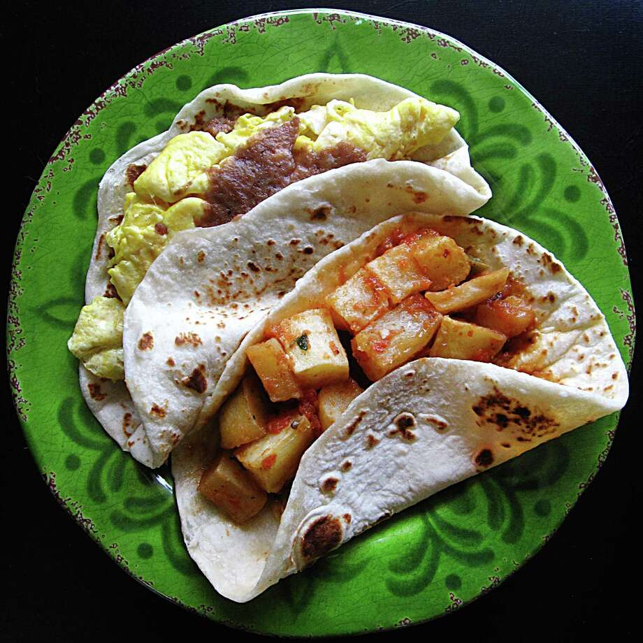 Bean and egg breakfast taco and a papas rancheras breakfast taco, both on handmade flour tortillas, from 4 Missions Cafe on Southton Road. Photo: Mike Sutter /San Antonio Express-News