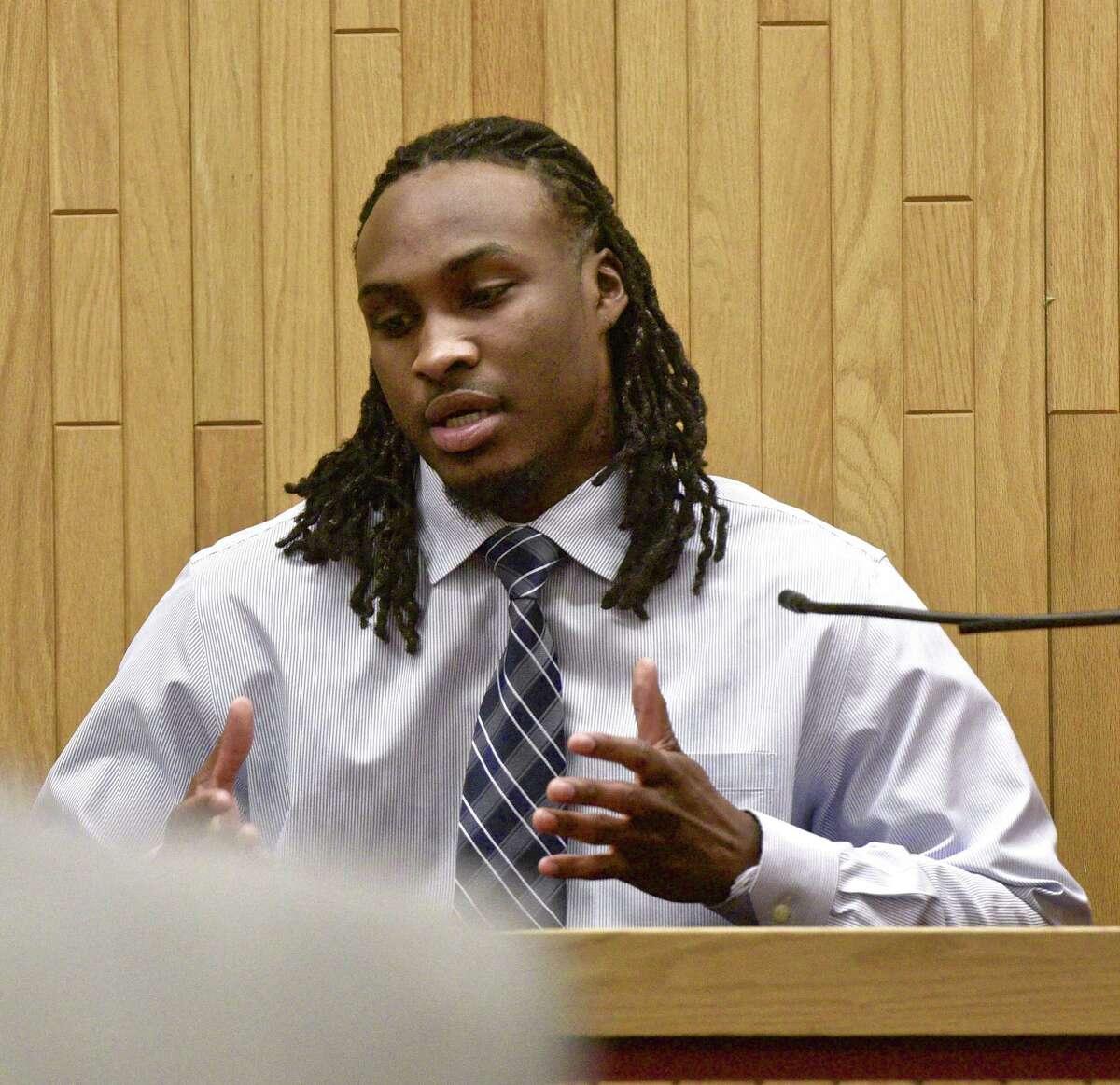 Murder suspect Garfield Sanderson testifies during his trial at Superior Court, in Danbury, on Thursday, March 30, 2017, in Danbury, Conn.