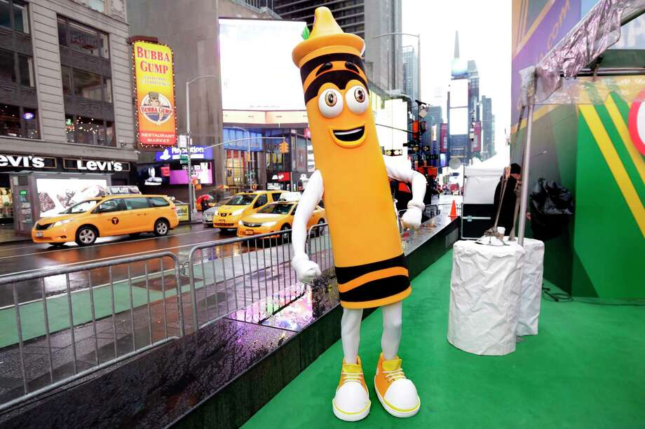 "A dandelion crayon character poses for photos during a Crayola event in New York's Times Square, Friday, March 31, 2017. Crayola announced Friday, National Crayon Day, that it's replacing the color dandelion in its 24-pack with a crayon in ""the blue family."" (AP Photo/Richard Drew) Photo: Richard Drew, STF / AP"